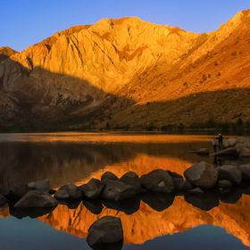 A Golden Sunrise at a picturesque lake.   The cloudless sky would have made this dawn trip a bust... had not the peaks lit up in this amazing gol...