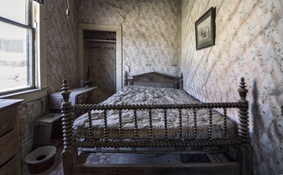 Bed and Crooked Walls
