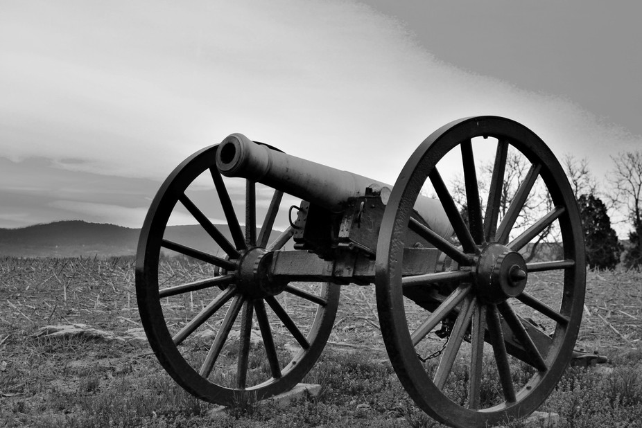 Black and white of a canon on the Antietam Battlefield, Sharpsburg, MD.  Taken at sunrise.