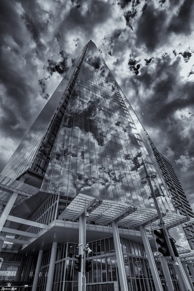 This shot was taken handheld whilst walking the rough the City i just loved the way the contrasty clouds reflected off the amazing glass structure  by Theo-Herbots-Fotograaf