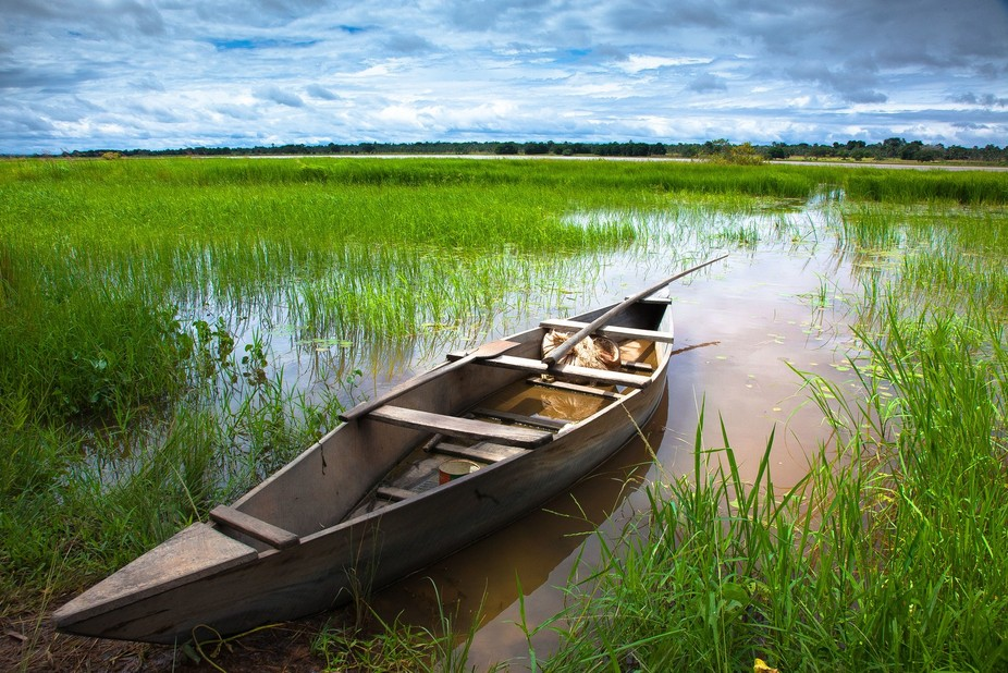A lone boat awaits customers to be rowed across the lake by skillful boats men. The attraction on...