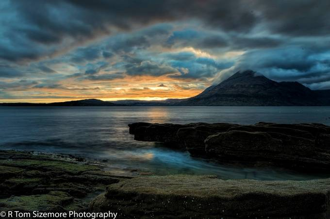 Taken in Engol, Isle of Skye, Scotland.  After a day of heavy overcast and occasional rain, I caught this tiny opening just at sunset.   This is a long (360 sec) exposure.