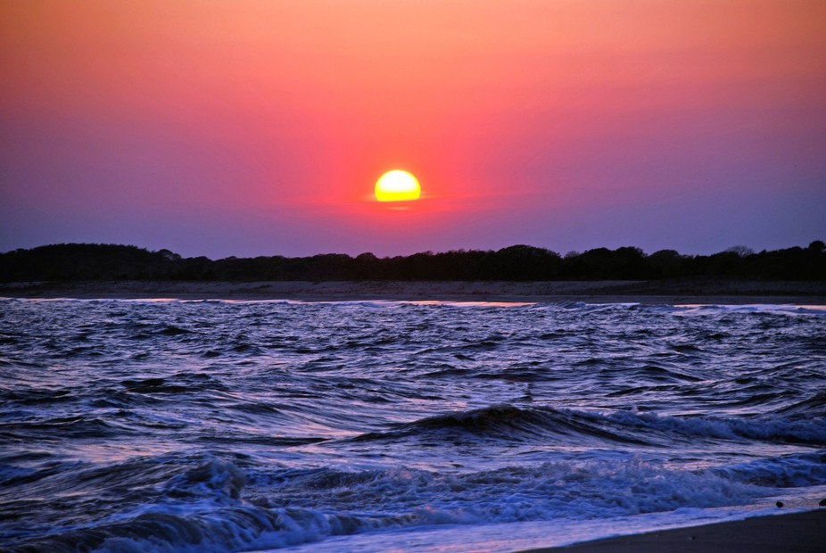 The sun sets on the beach at Cape May, NJ, a glorious place to watch it happen.