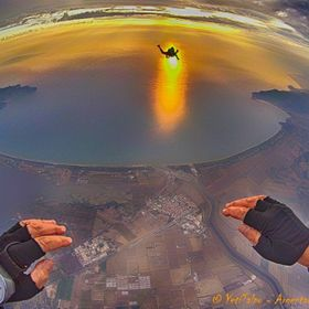 10.000 feet, sharing with a friend the wonderful Argentario bay, IT,  at sunset... freedom