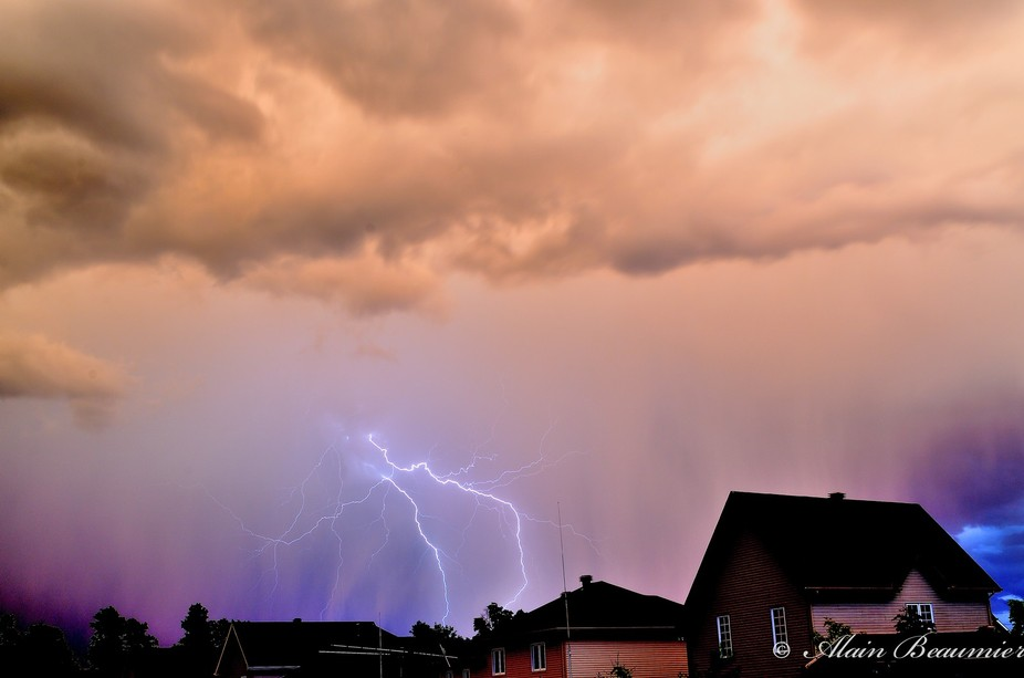 A thunder storm during an evening.  I took me a while to capture a good one and we can see the he...