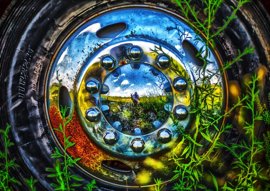 This is a 50mm HDR conversion. My reflection is in the center of the hub cap and I am giving a pe...