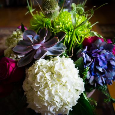 A photo from my birthday floral arrangement of hydrangeas,roses, succulents, and thistles. Gorgeous