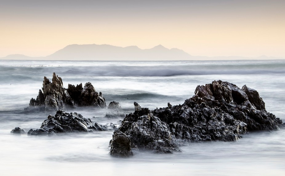Early evening .. rocks on the beach at Pringle Bay in Cape Town
