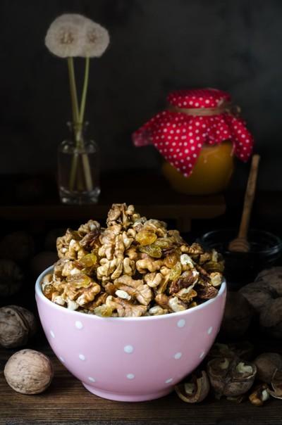 Bowl with walnut, still life dark photo