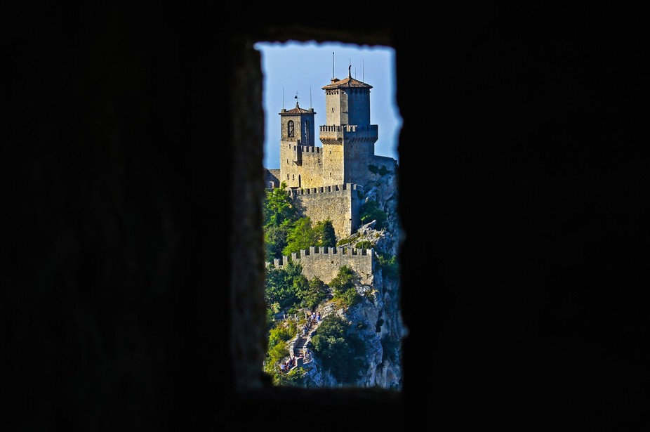 A view of San Marino castle through a guard tower window