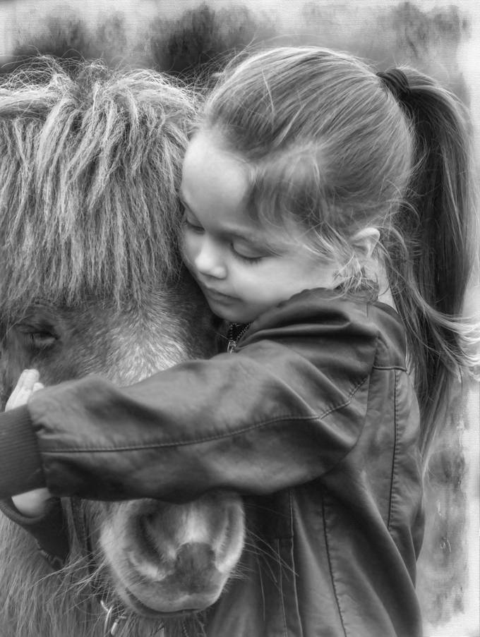 A little girl and her pony.