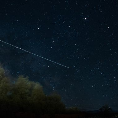 Air liner passing through a night long exposure near Borrego Springs, California