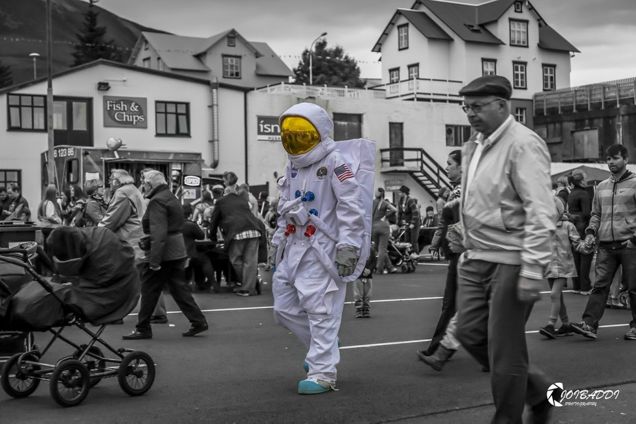 Astronaut walking around the harbour in Husavik Iceland on the towns festival day (mærudagar)