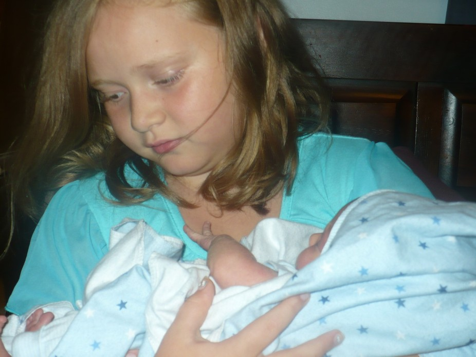Granddaughter Shae taking care of newborn little brother, Cash. Up All Night, can you tell?
