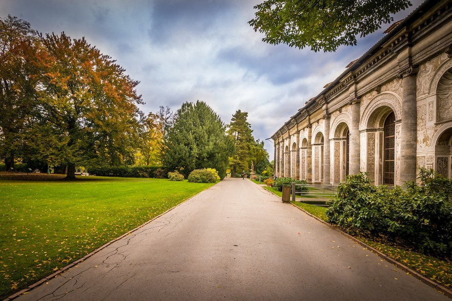 A gorgeous path in the middle of olden architecture and the beauty of nature.