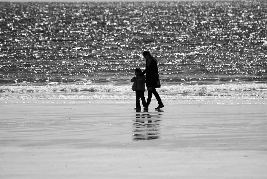 My wife and daughter strolling by the Clonea Beach in Dungarvan, Ireland