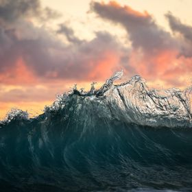 Backwash waves rising up against a rising sun on the East Coast of Australia