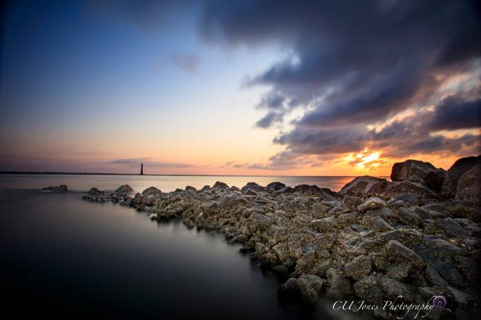 This is Morris Island Lighthouse side of Folly Beach. This is a very peaceful place and at low tide you can see all the rocks lined up.