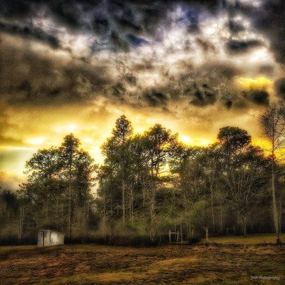 A Stormy Sunset:  The So-Called Calm Before The Storm.  The Simple Life in The Deep South.