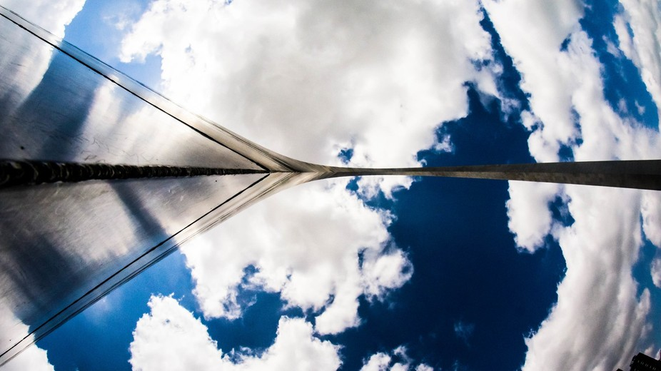 A shot straight up the St Louis Arch bissecting a beautiful sky