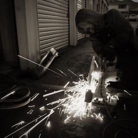 Black and white, welding at night; working overtime.