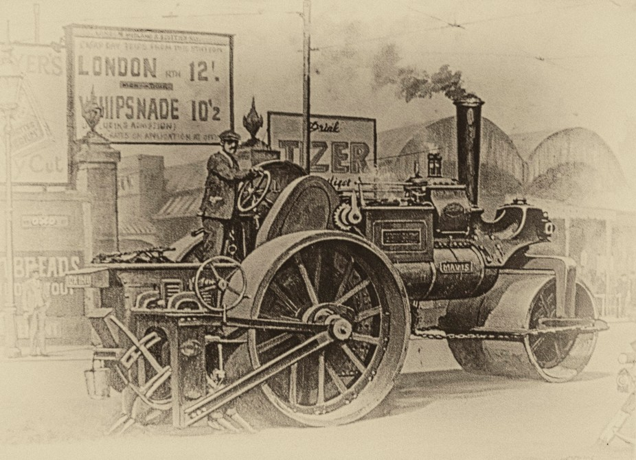 The original print is framed in a caravan pulled by a steam Roller