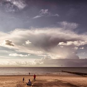 Probably my fave pic, the story here is amazing, cloud formations like this are very rare in England and the family on the beach agree. On a beac...