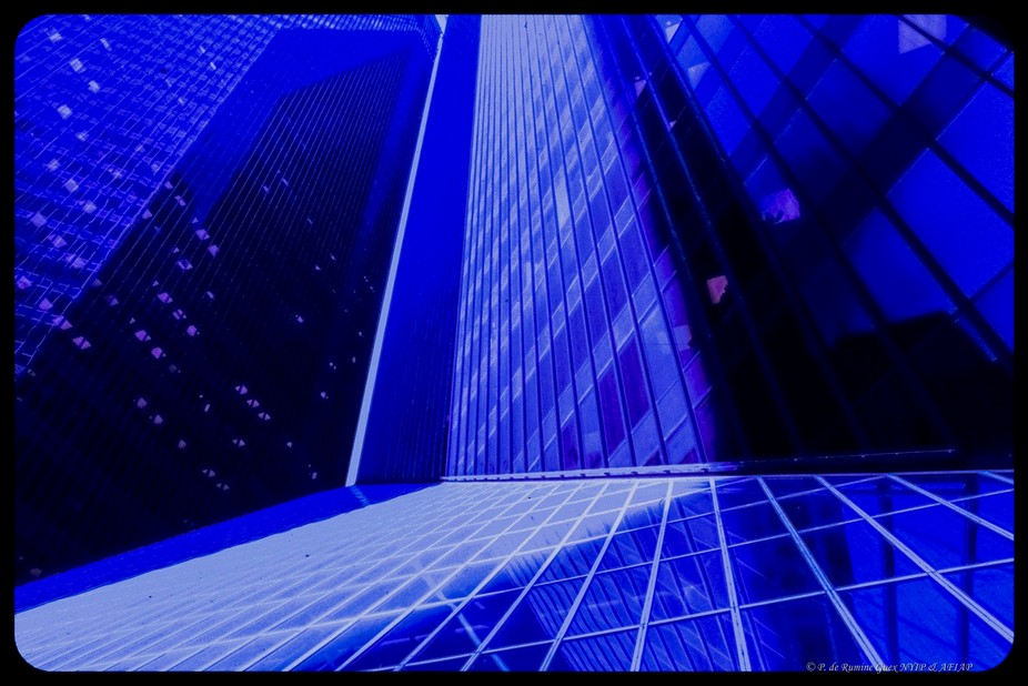 Skyscrapers offer elegant lines and colors when correctly filtered. The original is a a color slide that I scanned.