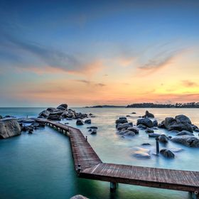 This boardwalk leads to a big rock off the shore at Banyan Tree Bintan. The hotel can arrange a romantic candle lit dinner for 2 on that rock at ...