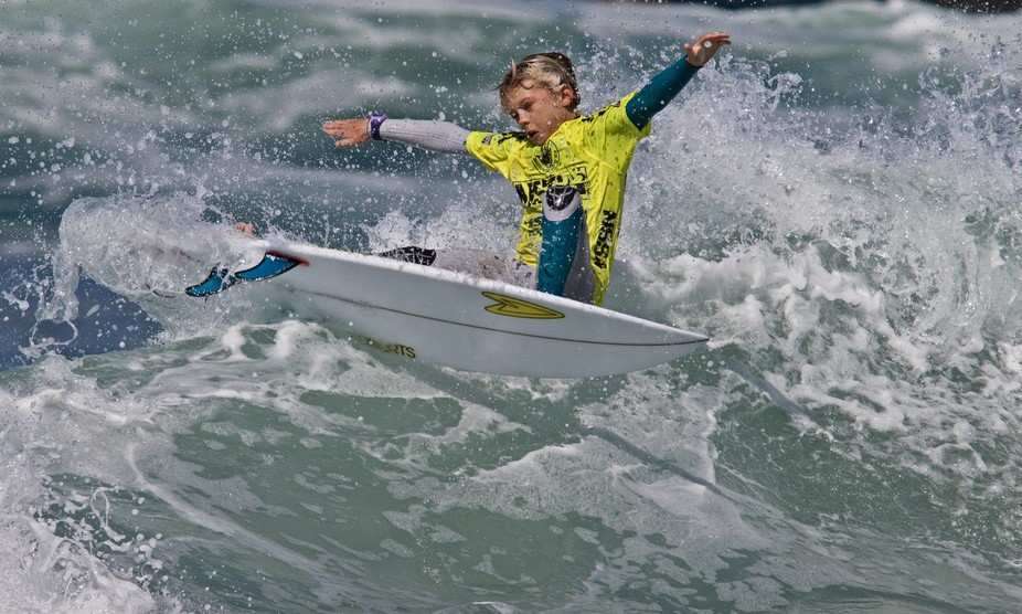 A talented grom in a NSSA contest in Huntington Beach, California