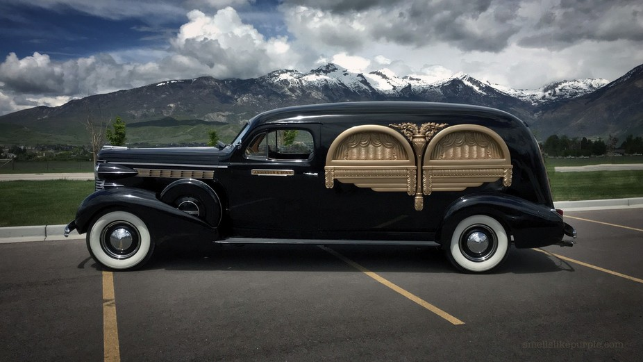 Saw this old hearse parked outside a local mortuary while out to lunch, sun at high noon phone pi...