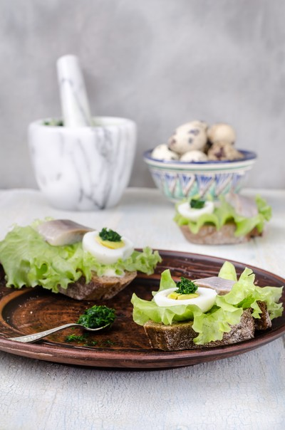 Sandwiches with herring, still life