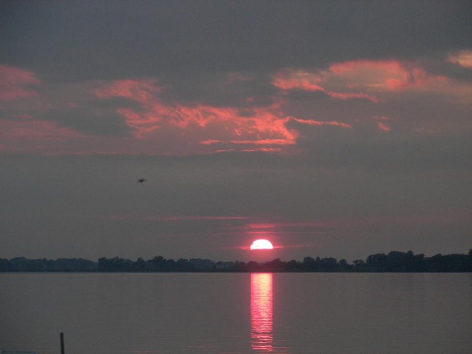 sun sets on Brant lake south dakota