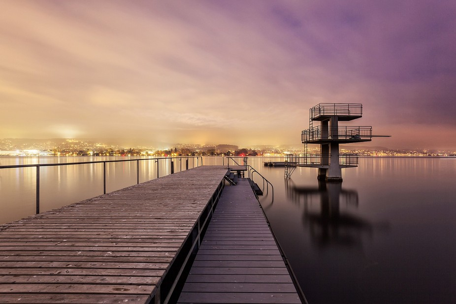 A swimming place at lake Zurich in Switzerland, taken after sunrise after a foggy day in octobre...