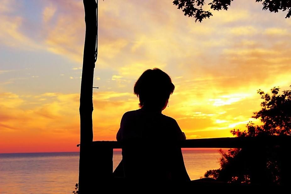 My beautiful aunt enjoying the beautiful sunset that Lake Michigan always provides.