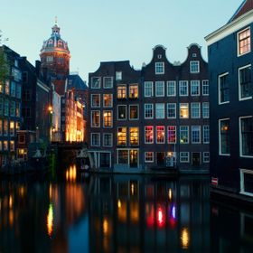 The world-famous and the World Heritage Site canals of Amsterdam are perfect for night time photography.  The colorful lights and the beautiful o...