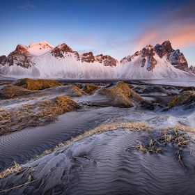 A golden morning at Vestrahorn mountain. Picture taken from Stoksness peninsula in east Iceland.
