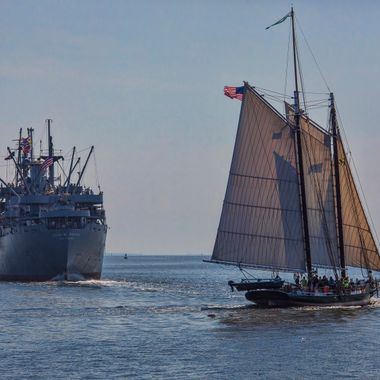The Liberty Ship SS John Borwn and the Pride of Baltimore cross paths on a summer cruise. Different periods in history taking folks back to another time.