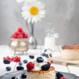 Ukrainian cheesecake with berries and cream, still life
