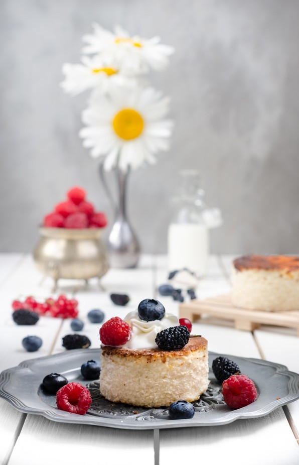 Ukrainian cheesecake with berries and cream, still life by denysskorikov - Delicious Photo Contest
