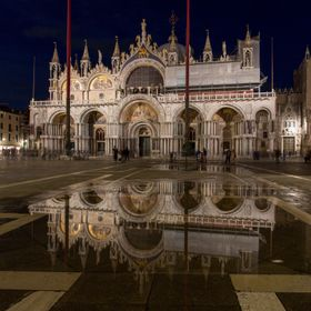 St Mark's Basilica with reflection in Venice at night after a little rain.