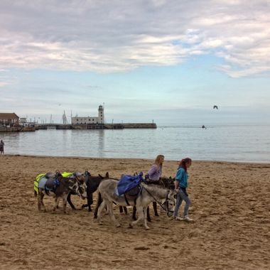 I took this photo last year (2015) when we were on holiday in the UK. Scarborough is a touristic town.  While we were walking near the beach I saw these two girls walking with their donkeys.