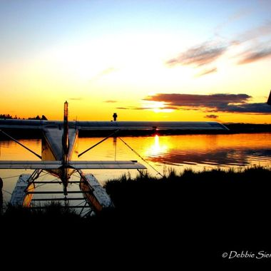 Another plane and sunset on Lake Hood in Alaska.