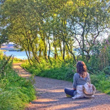 We were on holiday in  Scotland with my family last year (2015). We were driving in the Highlands around the lakes. In this photo we stopped at Loch Leven where we walked round the lake and took some photos.  In this photo you can see my daughter meditating.