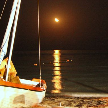 I took this photo at the Beach Club, Famagusta in 2012. The moon was shining over the sea and I took this photo.