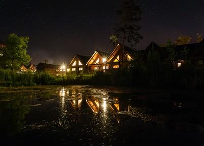 Cabins On A Lake at Night