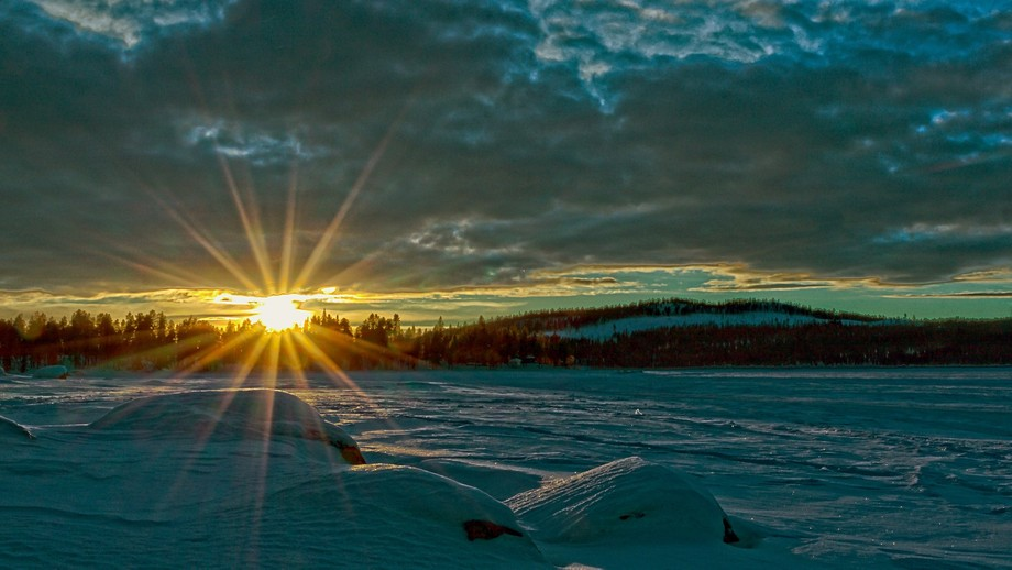 Sunrise over a frozen lake in northern Sweden
