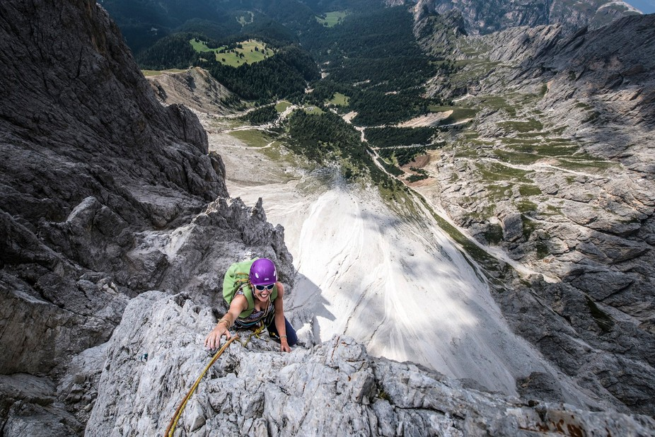 Climbing the Piaz Arete on Torre Delago at the Vajolet Towers, Dolomites.