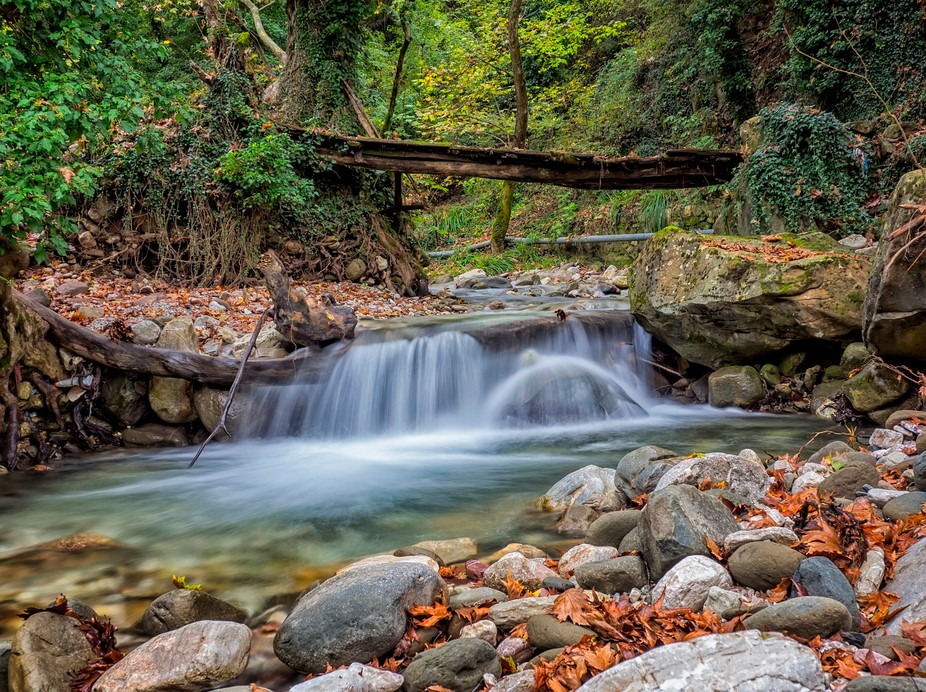 a creek with a small waterfall in Thessalia - Greece