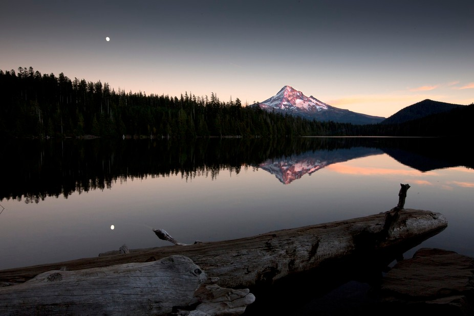 Last light on Mount Hood as a full moon rises above Lost Lake in Oregon, USA.